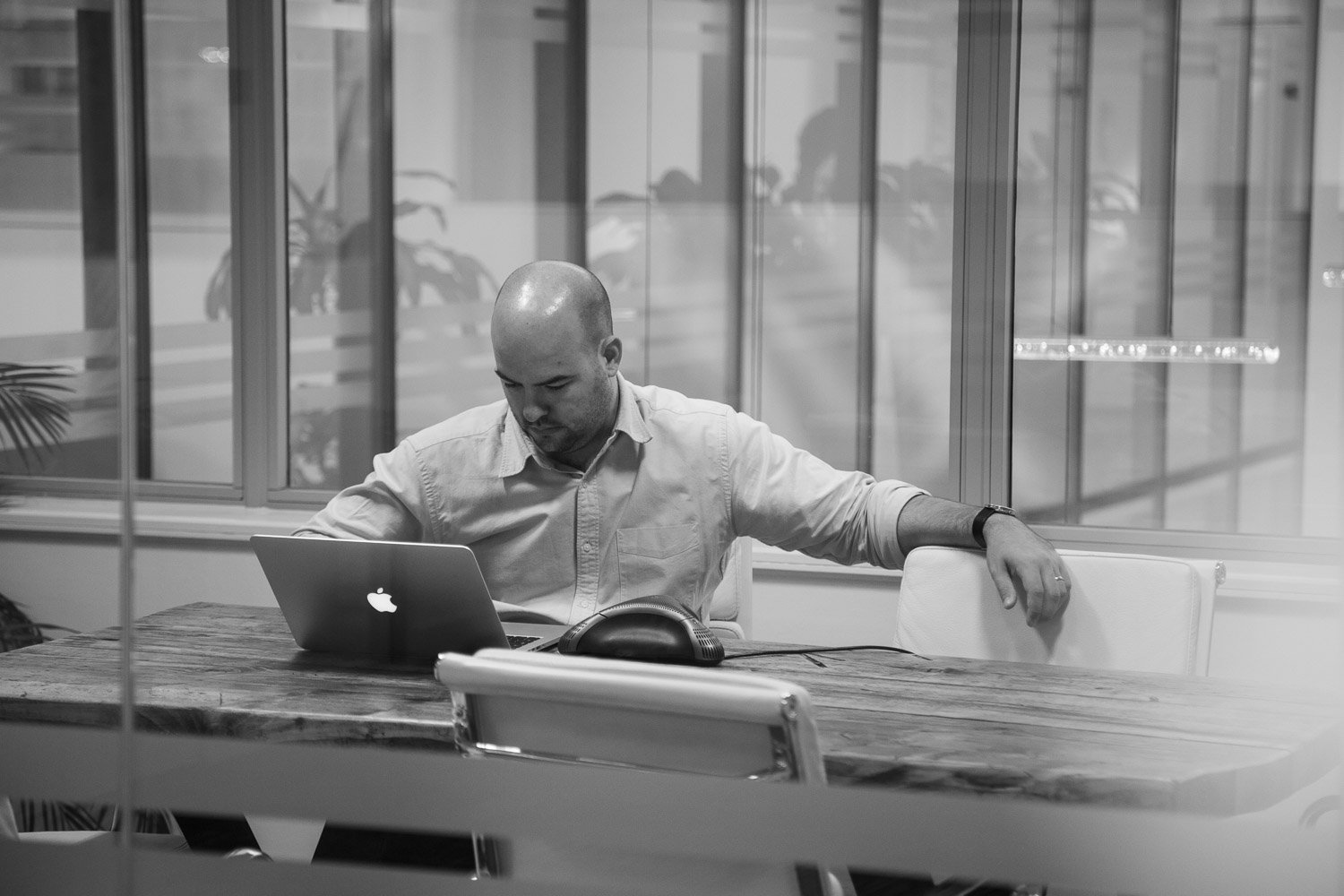 Working on the computer by Simon Clemenger photographer business portrait for Pegasus PR